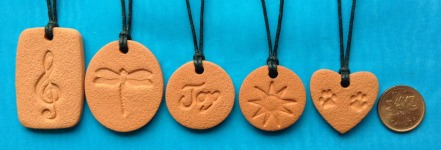 this photo shows the sizes of Terra Cotta Pendants