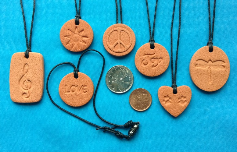 The different sizes of Terra Cotta Pendants